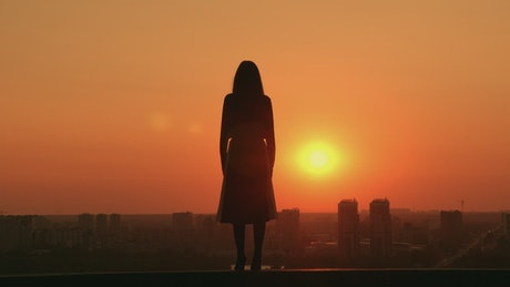 Woman during a sunset on a rooftop