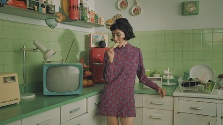 Woman eating a popsicle