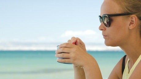 Woman eating ice cream at the coast