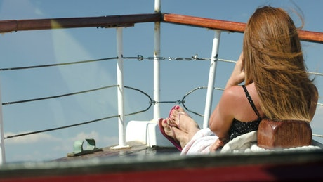 Woman enjoying the view from a boat