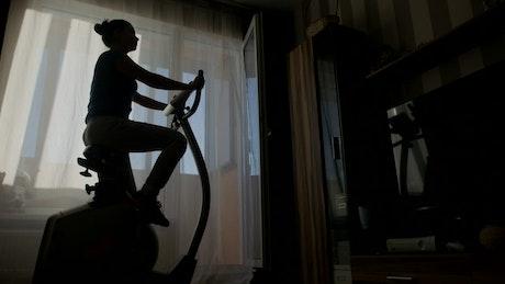 Woman exercising in dark room