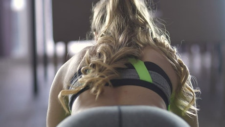 Woman exercising in her apartment
