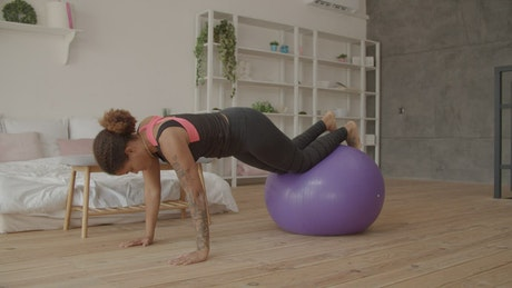 Woman exercising with a giant ball