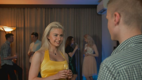 Woman flirting with a man at a party