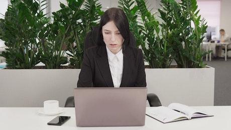 Woman gets bad news at work
