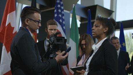 Woman gives an interview at an international summit