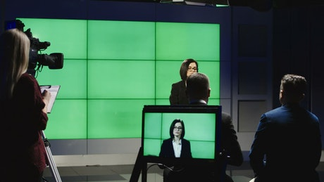Woman giving a speech on a television stage