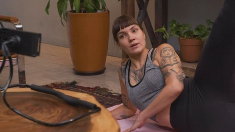 Woman giving an online fitness class