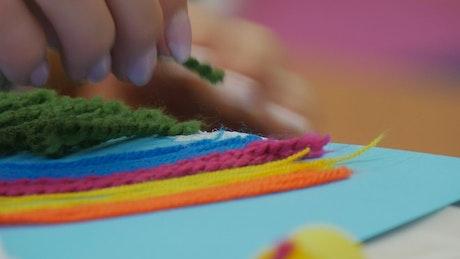 Woman hands working on handwork at school