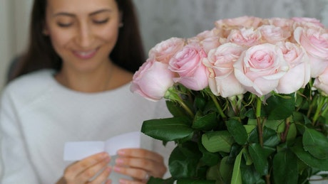 Woman happy to receive a bouquet of flowers