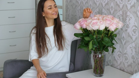 Woman happy to receive pink roses