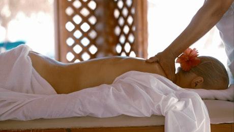 Woman having a body massage at a spa