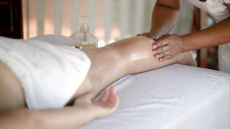 Woman having a leg massage on vacation