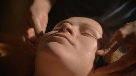 Woman having a relaxing face massage
