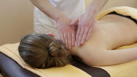 Woman having a shoulder massage