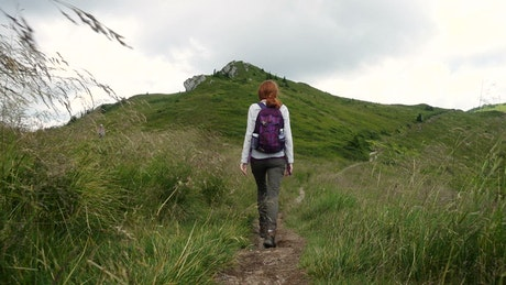 Woman hiking in a mountain path