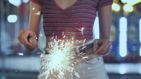 Woman holding a sparklers at the fair