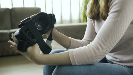 Woman holding a virtual reality headset