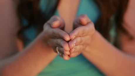 Woman holding grain in her hands