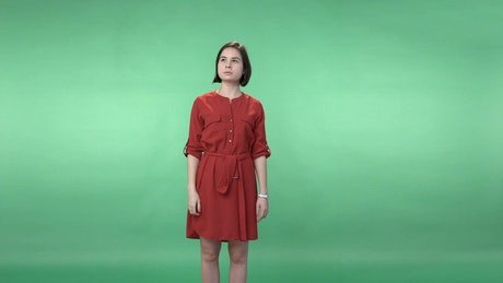 Woman in a dress using a virtual screen