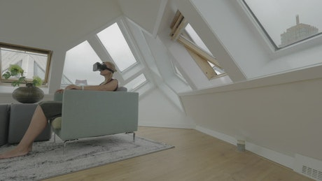 Woman in a modern apartment exploring VR