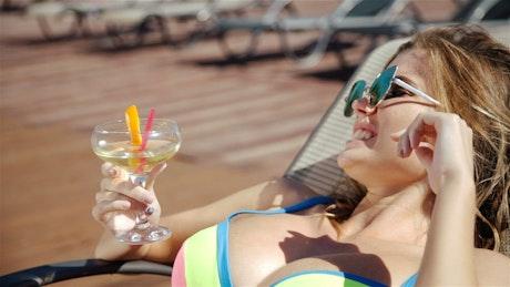 Woman in bikini sunbathing on a lounge chair