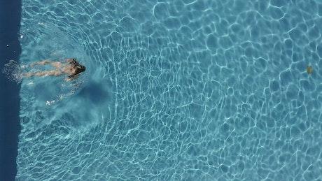 Woman in bikini swimming