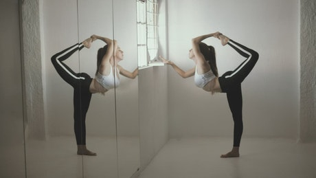 Woman in front of a window stretching