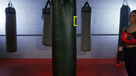 Woman kickboxing in the gym