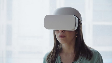 Woman looking around in VR glasses