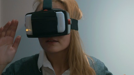 Woman looking around lost in VR