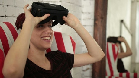 Woman lowering a VR headset