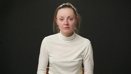 Woman massaging a headache