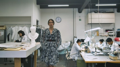 Woman modelling dress in a studio