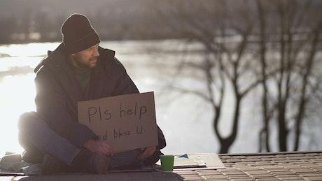 Woman offering a homeless man money