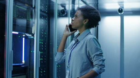 Woman on a phone call on data center