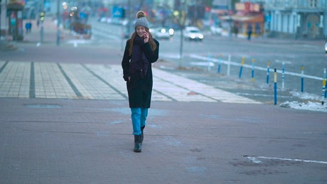 Woman on the phone walking in the street