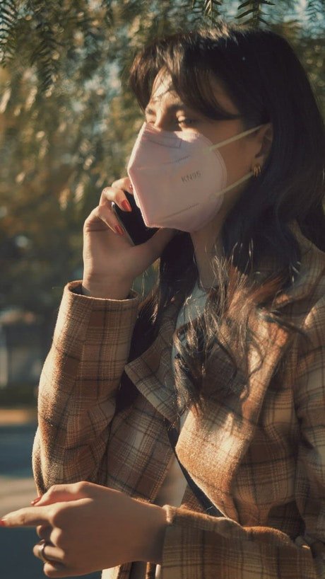Woman on the phone wearing mask