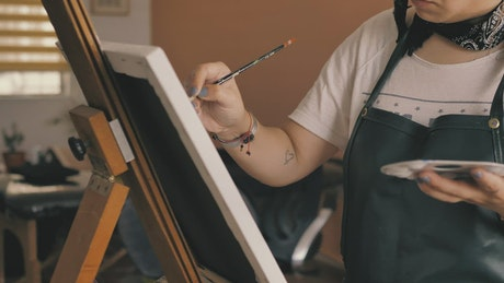 Woman painting a picture at home