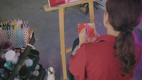 Woman painting a picture from a photograph