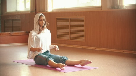 Woman placing her legs in yoga pose