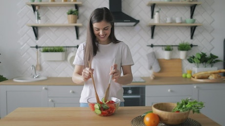 Woman preparing a healthy salad