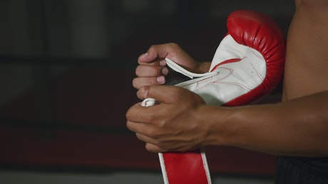 Woman putting on boxing gloves
