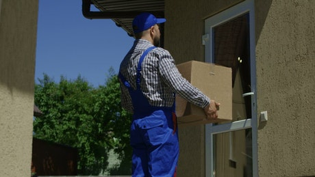 Woman receiving a package at home