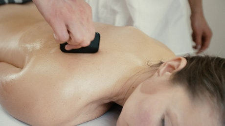 Woman receiving relaxing therapeutic massage in spa
