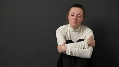Woman reflecting on a loss