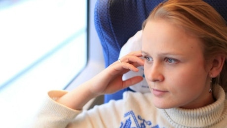 Woman relaxing during a train journey