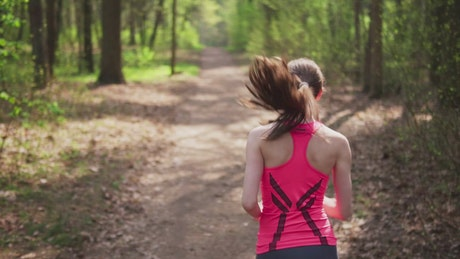 Woman running down a country path
