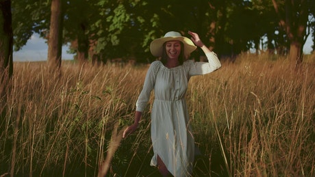 Woman running free through country field