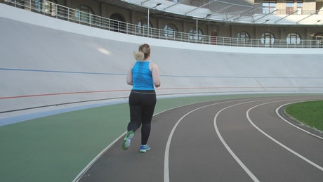 Woman running on a running track